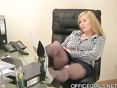 chubby secretary teases in the office in blue