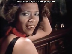 some porn movie scene with vintage pornstars