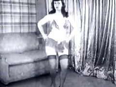 vintage: betty page and lucy kraven posing and