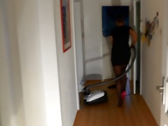 cleaning the house in one pink heel and nylons
