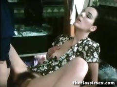 retro golden-haired pornstar in action