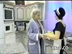 old woman and young maid in the kitchen