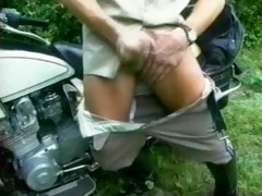 motorcycle cop with his bike