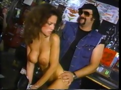 biker fucks skank up the ass on a hog
