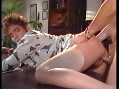 vintage scene of a sexy blonde getting a head