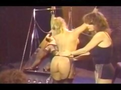 retro lesbo group flogging lesbo gal on beauty